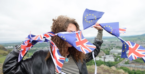Woman with UK and EU Flags