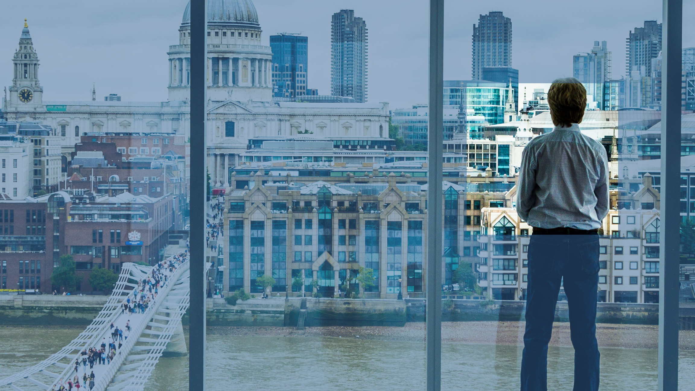 Man looking at London skyline