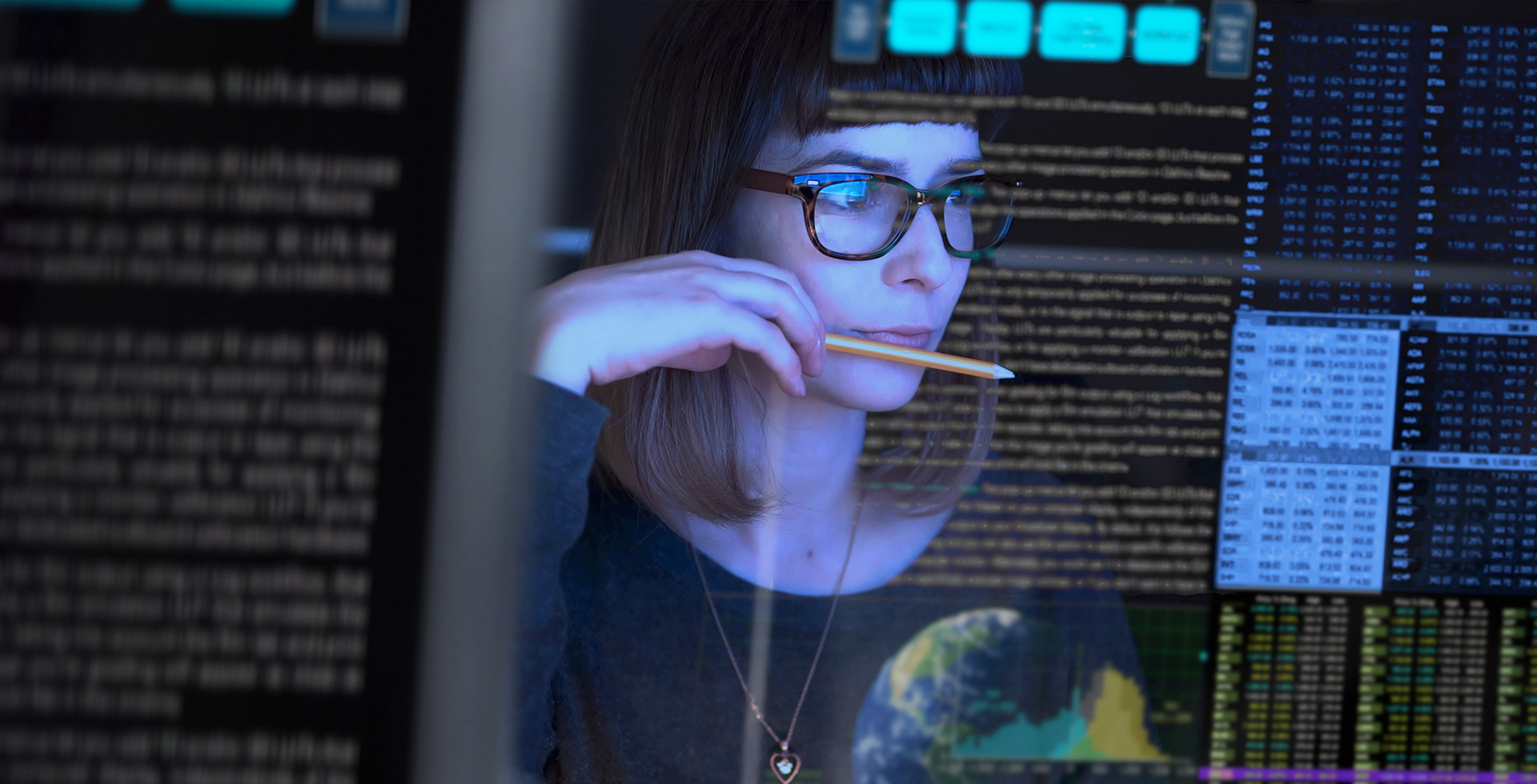 woman watching multiple monitors
