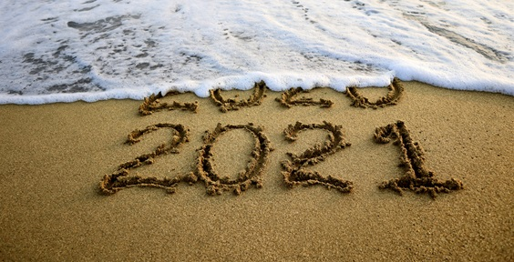 2021 written on a beach