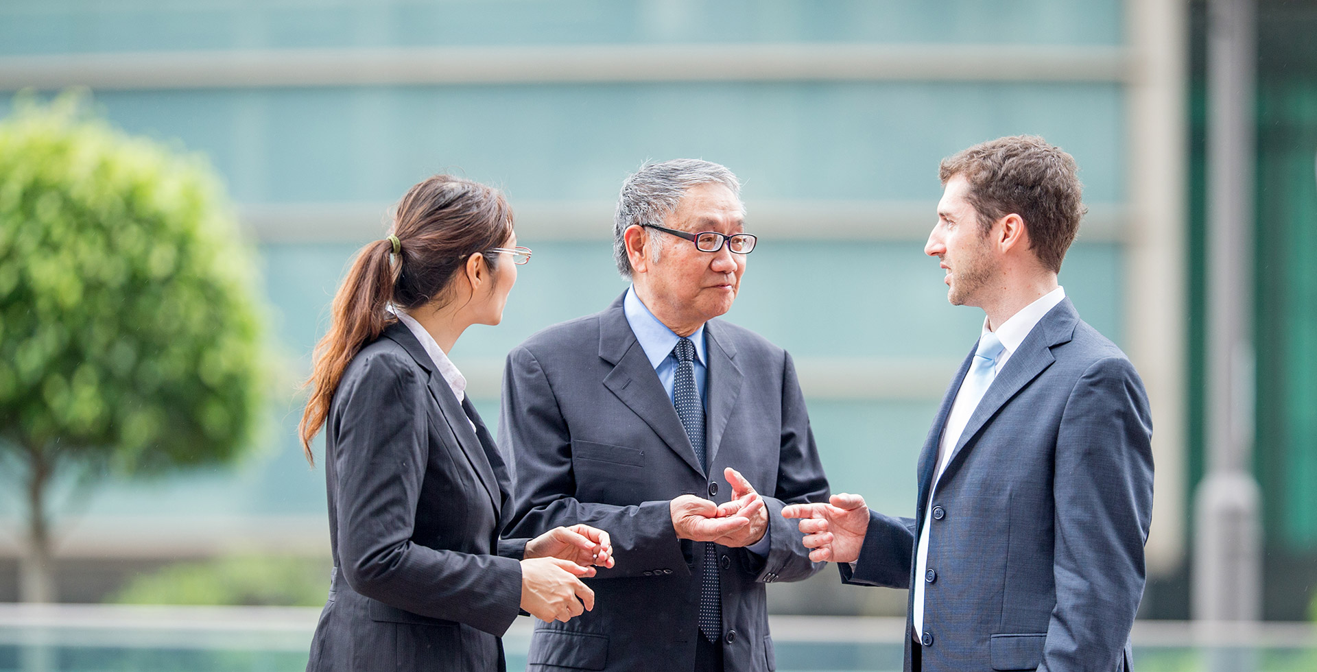 Three business people discussing
